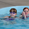 Jordan Kingsbury, 11, left, and Caitlin McFarlane, 12, team up for the World's Largest Swim Lesson at the Broomfield Academy on Thursday.<br /> <br /> June 14, 2012 <br /> staff photo/ David R. Jennings