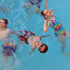 Calvin Wagner, 10, left, Alex Luong, 11, and Syndey Wagner, 12, practice floating in the water while participating in the World's Largest Swim Lesson at the Broomfield Academy on Thursday.<br /> <br /> June 14, 2012 <br /> staff photo/ David R. Jennings