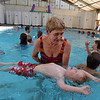 Monique Pope helps beginning swimmer Sebastian Tschopp, 3, learn how to float in the pool during  the World's Largest Swim Lesson at the Broomfield Academy on Thursday.<br /> <br /> June 14, 2012 <br /> staff photo/ David R. Jennings