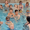 Children swim across the pool during the World's Largest Swim Lesson at the Broomfield Academy on Thursday.<br /> <br /> June 14, 2012 <br /> staff photo/ David R. Jennings