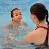 Isabela Torales-Rios, 4, swims to instructor Aubrey Kane during  the World's Largest Swim Lesson at the Broomfield Academy on Thursday.<br /> <br /> June 14, 2012 <br /> staff photo/ David R. Jennings