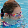 Sydney Wagner, 12, learns to blow bubbles under the water during the World's Largest Swim Lesson at the Broomfield Academy on Thursday.<br /> <br /> June 14, 2012 <br /> staff photo/ David R. Jennings