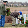 Joe  Dankey, left, and Lew Moir place holiday wreaths on the graves of military veterans  at the Broomfield County Commons Cemetery for the Wreaths Across America on Saturday. The Broomfield Rotary Club sponsored event placed wreaths on the graves of veterans at three cemeteries simultaneously.<br /> December 14, 2012<br /> staff photo/ David R. Jennings