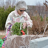 Lou Jean Anderson places a holiday wreath on the grave of her husband Ronald Keith Anderson, a military veteran, on Saturday at the Broomfield County Commons Cemetery for the Wreaths Across America. The Broomfield Rotary Club sponsored event placed wreaths on the graves of veterans at three cemeteries simultaneously.<br /> December 14, 2012<br /> staff photo/ David R. Jennings