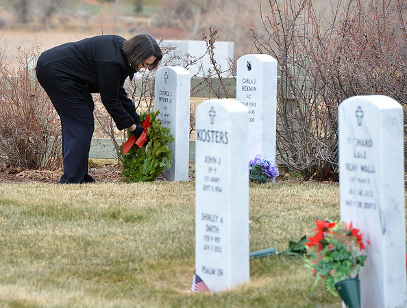 Edna Pfeifer places a holiday wreath on the grave of her husband, US Army veteran, George Pfeifer Jr. on Saturday at the Broomfield County Commons Cemetery for the Wreaths Across America. <br /> December 14, 2012<br /> staff photo/ David R. Jennings