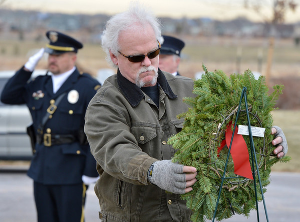 John Fitzgerald places a wreath honoring the soldiers missing in action during the Wreaths Across America ceremony to place holiday wreaths at the graves of military veterans on Saturday at the Broomfield County Commons Cemetery. The Broomfield Rotary Club sponsored event placed wreaths on the graves of veterans at three cemeteries simultaneously.<br /> December 14, 2012<br /> staff photo/ David R. Jennings