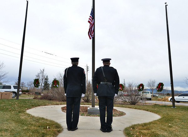 Honor Gurad members Curtis Krantz, North Metro Fire, and Doug Whiles, Broomfield Police, stand at attention in front of the 7 wreaths representing the military branches and missing in action soldiers on Saturday at the Broomfield County Commons Cemetery for the Wreaths Across America. The Broomfield Rotary Club sponsored event placed wreaths on the graves of veterans at three cemeteries simultaneously.<br /> December 14, 2012<br /> staff photo/ David R. Jennings