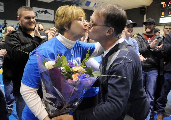 Broomfield High's head wrestling coach Mark Schmidt kisses his wife Laurena during a ceremony celebrating his career at his last home wrestling match on Thursday.  Schmidt is retiring from coaching and teaching this year.<br /> <br /> January 28, 2010<br /> Staff photo/David R. Jennings