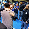 Mark Schmidt, Broomfield High's wrestling coach, greets his former players and assistant coaches during a ceremony celebrating his career at his last home wrestling match on Thursday. After 32 years Schmidt is retiring from coaching and teaching this year.  <br /> <br /> January 28, 2010<br /> Staff photo/David R. Jennings