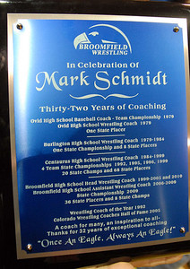 The plaque showning the accomplishment of  Mark Schmidt, Broomfield High's head wrestling coach, who is retiring this year. January 28, 2010 Staff photo/David R. Jennings