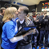 Surrounded by former players and assistant coaches, Mark Schmidt, Broomfield High's wrestling coach, accepts a plaque from principal Ginger Ramsey during a ceremony celebrating his career at his last home wrestling match on Thursday. After 32 years Schmidt is retiring from coaching and teaching this year. <br /> <br /> January 28, 2010<br /> Staff photo/David R. Jennings
