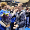 Mark Schmidt, left, Broomfield High's head wrestling coach greets his wife Laurena and daughter Andrea Schiola, far left, before the wrestling match on Thursday.  <br /> <br /> January 28, 2010<br /> Staff photo/David R. Jennings