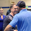 Mark Schmidt, left,  Broomfield High's wrestling coach, greets his first state placer Todd Harrington from Ovid, Colorado, during a ceremony celebrating his career at his last home wrestling match on Thursday. After 32 years Schmidt is retiring from coaching and teaching this year. <br /> <br /> January 28, 2010<br /> Staff photo/David R. Jennings