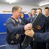Mark Schmidt, center, Broomfield High's wrestling coach, accepts a gift from the team before his last home wrestling match on Thursday. After 32 years Schmidt is retiring from coaching and teaching this year.  <br /> <br /> January 28, 2010<br /> Staff photo/David R. Jennings