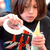 Riki Ramerez, 9, tapes on the nose cone to his rocket during the Rocket Works program Saturday at Mamie Doud Eisenhower Public Library.<br /> <br /> February 6, 2010<br /> Staff photo/David R. Jennings