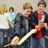 Ethan Curtis, 10, left, and Parker Loertscher, 10, try to inflate a balloon, before it explodes, for a rocket experiment during the Rocket Works program Saturday at Mamie Doud Eisenhower Public Library.<br /> <br /> February 6, 2010<br /> Staff photo/David R. Jennings