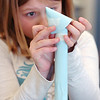 Kendall Monley, 10, put a nose cone on a paper rocket she's buiding during the Rocket Works program Saturday at Mamie Doud Eisenhower Public Library.<br /> <br /> February 6, 2010<br /> Staff photo/David R. Jennings