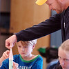 Steven Abel, 9, left, gets little help from his father Glenn Abel, an employee of Lockheed Martin, with assembling paper rockets during the Rocket Works program Saturday at Mamie Doud Eisenhower Public Library.<br /> <br /> February 6, 2010<br /> Staff photo/David R. Jennings