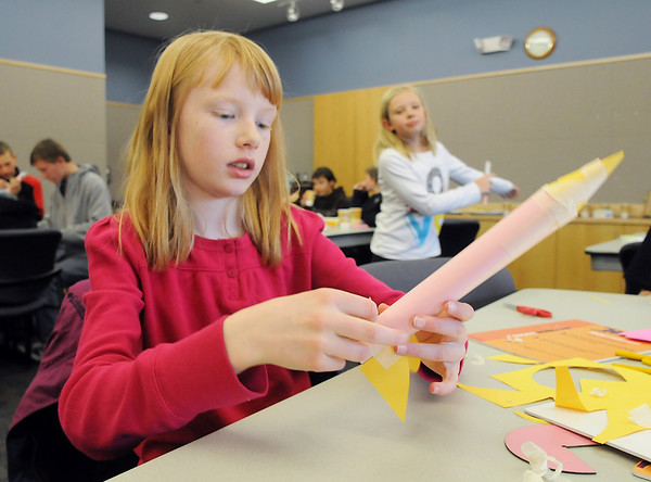 Emily Braddock, 11, builds her rocket out of paper during the Rocket Works program Saturday at Mamie Doud Eisenhower Public Library.<br /> <br /> February 6, 2010<br /> Staff photo/David R. Jennings