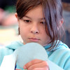 Olivia Tenaglia, 9, cuts out a nose cone for her paper rocket during the Rocket Works program Saturday at Mamie Doud Eisenhower Public Library.<br /> <br /> February 6, 2010<br /> Staff photo/David R. Jennings