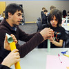 Eric Hoffman, left, helps Riki Ramerez, 9, with his rocket during the Rocket Works program Saturday at Mamie Doud Eisenhower Public Library.<br /> <br /> February 6, 2010<br /> Staff photo/David R. Jennings