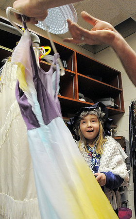 Sierra George, 10, looks at her costumes during a fitting session for the performance of Giving based on Shel Silverstein's The Giving Tree during the Young Actors Theatre Camp by the Broomfield High School Thespians at the school on Wednesday. <br /> December 29, 2010<br /> staff photo/David R. Jennings
