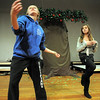Broomfield High thespian Madison Goering, left, helps Chloe Malecha, 10, practice her dance routine during the Young Actors Theatre Camp by the Broomfield High School Thespians at the school on Tuesday. <br /> December 29, 2010<br /> staff photo/David R. Jennings