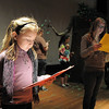 Sierra George, 10, left, and Beth Allen, 12, read their narrator parts for the performance of Giving based on Shel Silverstein's The Giving Tree during the Young Actors Theatre Camp by the Broomfield High School Thespians at the school on Tuesday. <br /> December 29, 2010<br /> staff photo/David R. Jennings