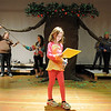 Anna Schoenfeld, 8, rehearses her lines while the high school thespians work with the arms of the tree for the performance of Giving based on Shel Silverstein's The Giving Tree  during the Young Actors Theatre Camp by the Broomfield High School Thespians at the school on Tuesday. <br /> December 29, 2010<br /> staff photo/David R. Jennings