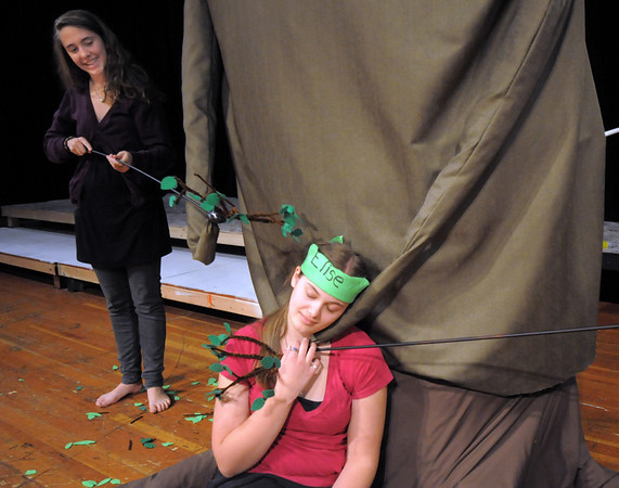 Broomfield High thespian Elise Princehouse, right, sits while Rachel Kois, left, practices arm movements of the Giving Tree during the Young Actors Theatre Camp by the Broomfield High School Thespians at the school on Tuesday. <br /> December 29, 2010<br /> staff photo/David R. Jennings