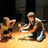 Christina Perez, 8, left, rehearses her puppet skit with Michael Lund, 18, during the Young Actors Theatre Camp by the Broomfield High School Thespians at the school on Tuesday. <br /> December 29, 2010<br /> staff photo/David R. Jennings