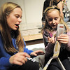 Madison Goering, left, helps Sierra George,10, with making a newspaper puppet during the Young Actors Theatre Camp by the Broomfield High School Thespians at the school on Tuesday. <br /> December 29, 2010<br /> staff photo/David R. Jennings