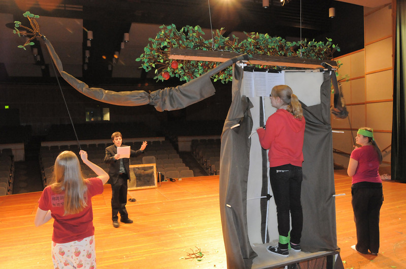 Beth Allen, 12, center, rehearses being the puppeteer of the Giving Tree with the aid of the high school thespians Madison Goering, left, and Elise Princehouse, right, directed by Brenton Daviau, 22, for the performance of Giving based on Shel Silverstein's The Giving Tree during the Young Actors Theatre Camp by the Broomfield High School Thespians at the school on Wednesday.  <br /> December 29, 2010<br /> staff photo/David R. Jennings
