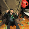 Brenton Davian, 22, stands in for campers while directing Broomfield High thespians on the movement of the Giving Tree's arms during the Young Actors Theatre Camp by the Broomfield High School Thespians at the school on Tuesday. <br /> December 29, 2010<br /> staff photo/David R. Jennings