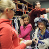 Campers Beth Allen, 12, left, Chloe Malecha, 10, and Sierra George, 10, are fitted for costumes with Broomfield High theater teacher Robert Scott during the Young Actors Theatre Camp by the Broomfield High School Thespians at the school on Wednesday. <br /> December 29, 2010<br /> staff photo/David R. Jennings
