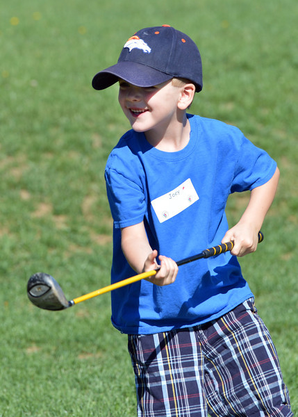 Joey Kolodgy, 4, smiles after hitting a drive during Thursday's Youth Golf Camp at Eagle Trace Golf Course.<br /> <br /> July 19, 2012<br /> staff photo/ David R. Jennings