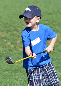 Joey Kolodgy, 4, smiles after hitting a drive during Thursday's Youth Golf Camp at Eagle Trace Golf Course.  July 19, 2012 staff photo/ David R. Jennings