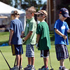 Young golfers in the 5 -7 year old group line up to putt during Thursday's Youth Golf Camp at Eagle Trace Golf Course.<br /> <br /> July 19, 2012<br /> staff photo/ David R. Jennings
