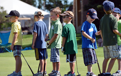 Young golfers in the 5 -7 year old group line up to putt during Thursday's Youth Golf Camp at Eagle Trace Golf Course.  July 19, 2012 staff photo/ David R. Jennings