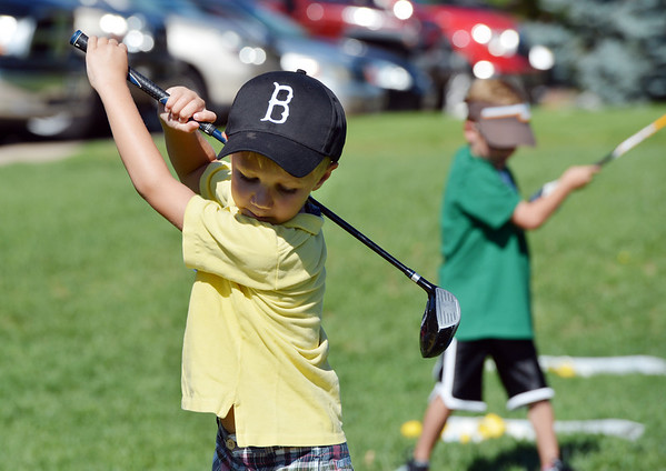 Cole Martin swings his driver during Thursday's 5 - 7 year old Youth Golf Camp at Eagle Trace Golf Course.<br /> <br /> July 19, 2012<br /> staff photo/ David R. Jennings