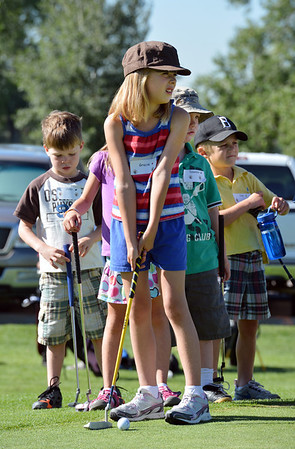 Gracie Kolodgy, 8, center, prepares to make a putt during Thursday's Youth Golf Camp at Eagle Trace Golf Course.<br /> <br /> July 19, 2012<br /> staff photo/ David R. Jennings