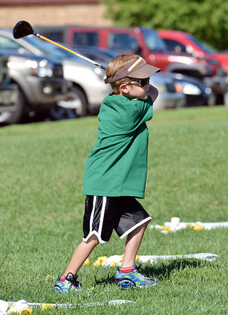 Jack Winter, 6, watches where the Birdie Ball lands during Thursday's Youth Golf Camp at Eagle Trace Golf Course.<br /> <br /> <br /> July 19, 2012<br /> staff photo/ David R. Jennings
