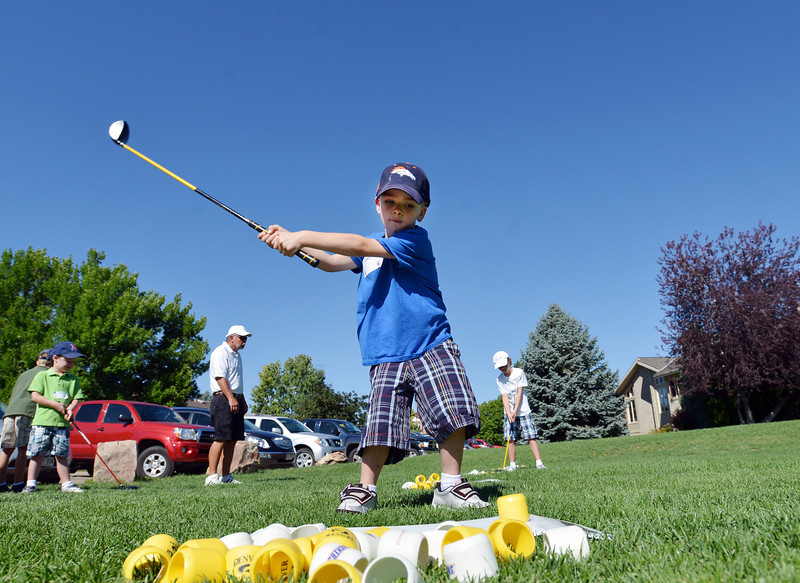 Joey Kolodgy, 4, swings his driver to hit Birdie Balls during Thursday's Youth Golf Camp at Eagle Trace Golf Course.<br /> <br /> July 19, 2012<br /> staff photo/ David R. Jennings