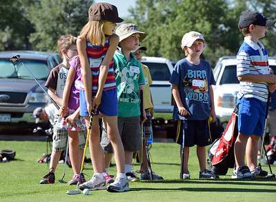 Gracie Kolodgy, 8, center, prepares to make a putt during Thursday's Youth Golf Camp at Eagle Trace Golf Course.  July 19, 2012 staff photo/ David R. Jennings