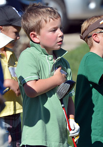 Tyler Reichenberg, 6, left, watches other golfers while waiting his turn to hit the ball during Thursday's Youth Golf Camp at Eagle Trace Golf Course.  July 19, 2012 staff photo/ David R. Jennings
