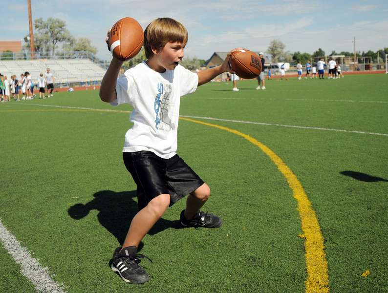Cameron Shelley, 9, does a touchdown dance during Broomfield High School Football Camp at Elizabeth Kennedy Stadium on Tuesday.<br /> July 27, 2010<br /> Staff photo/ David R. Jennings