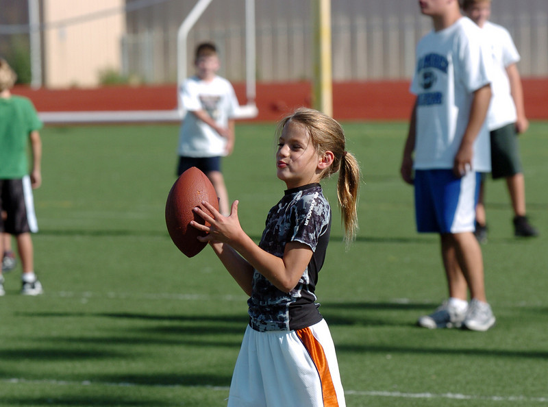 Ilan Marinoff, 7, gets ready to through a pass during Broomfield High School Football Camp at Elizabeth Kennedy Stadium on Tuesday.<br /> July 27, 2010<br /> Staff photo/ David R. Jennings