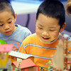 Samuel Law, 5, left, John Liu, 5, and  Sherry Newell-Chandler watch trains move through the exhibit during the Youth in Model Railroading exhibit at Mamie Doud Eisenhower Public Library's Children's Library on Saturday.<br /> <br /> Sept. 26, 2009<br /> Staff photo/David R. Jennings