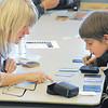 Sheryl Baltzer, 50, left, discusses the different aspects of a card with Noah Parko, 11, while playing a game in the Yu-Gi-Oh! tournament at Mamie Doud Eisenhower Public Library on Tuesday.<br /> November 23, 2010<br /> staff photo/David R. Jennings