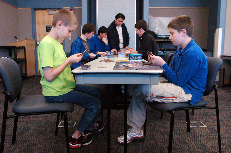 Ethan Cranston, 9, left, plays Jonathan Guener, 10 during the Yu-Gi-Oh! tournament at Mamie Doud Eisenhower Public Library on Tuesday.<br /> November 23, 2010<br /> staff photo/David R. Jennings